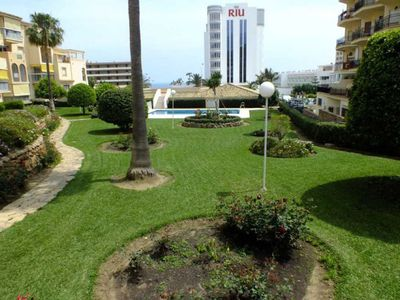 Photo for Air-Conditioned Apartment Close to Beach with Rooftop Terrace, Sea View, Pool & Wi-Fi; Parking Available, 1 Pet Allowed