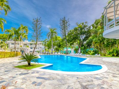 Photo for Garden-level studio w/ shared pool - steps to beach, dining & shopping!