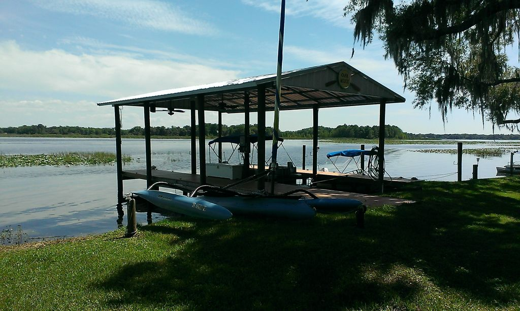 Beautiful lake front home located on large freshwater for Lake front view