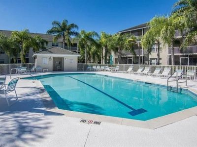 Photo for Private 2/2 top floor near Naples with pool and hot tub