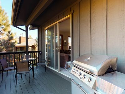 Photo for NEW LISTING! Wooded getaway w/fireplace, balcony, shared pool & hot tub