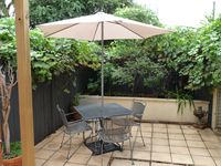 North facing rear courtyard with BBQ