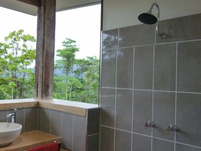 Semi-open bathroom with a view