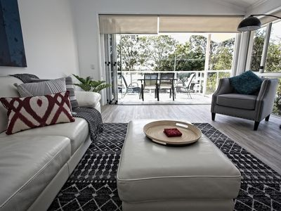 Spacious living with balcony views of the Noosa River