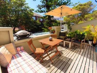 Large entertaining balcony, with BBQ and dining set, umbrella, hammock etc
