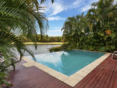 Private inground pool with views of the lake and Palms golf course