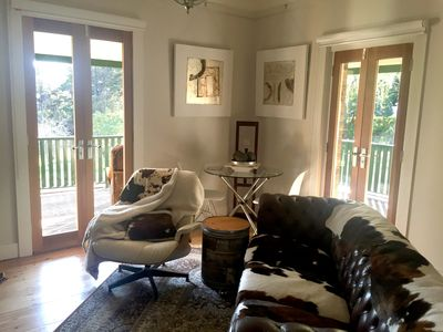 Sitting room with dining area and french doors to the sun-drenched verandah