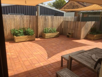 The outdoor area with the spa in the corner