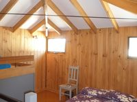 Upstairs loft style bedroom with queen bed and ensuite