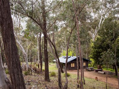 Secluded and private log cottages by a crystal clear mountain river