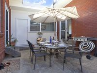 Courtyard with BBQ, outdoor setting and market umbrella