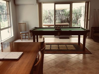 Dining table and pool table.