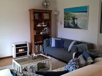 Comfortable living room with TV/DVD and gas heater