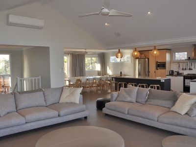 Living room, dining space and kitchen