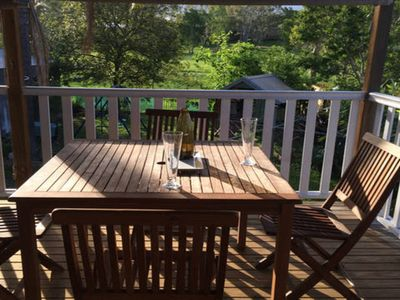 Enjoy the back deck, overlooking the private back yard and park