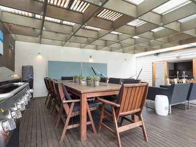 Outdoor undercover entertaining area with BBQ and patio heater