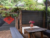 Covered outside garden dining area with BBQ