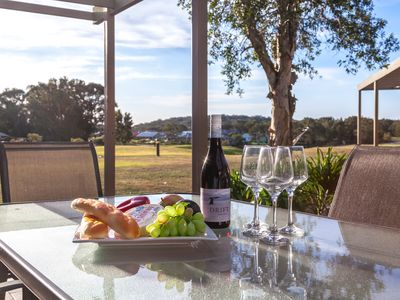 Enjoy The View over Golf Course with Wine and Nibbles or a Meal