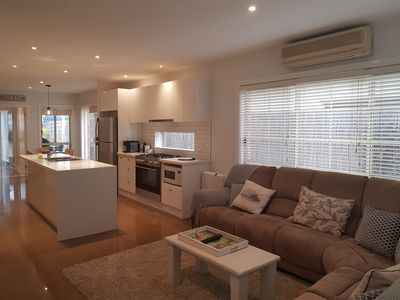 Open plan living, kitchen, dining, flatscreen TV, gas heater/air con