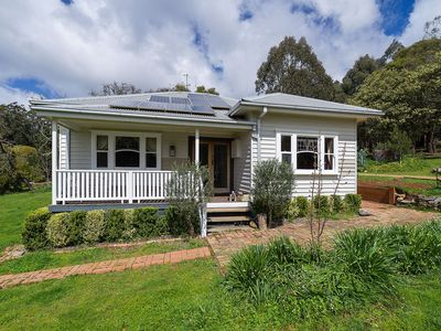 ArtDeco decorated Cal Bungalow on 1.2 acres, bordering the Wombat State Forest.