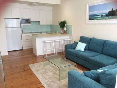 Open plan lounge kitchen area with all new appliances