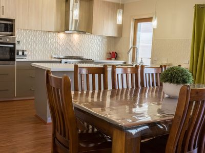 Two ovens and ten seater dining table for large groups to enjoy