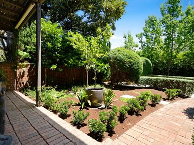 A secluded front garden behind a high wall makes for a private oasis