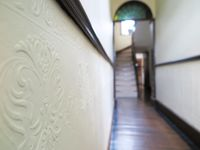 Pressed tin original wall mouldings on entry