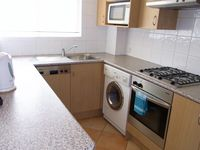 full size kitchen all apartments: Parramatta View Furnished Apartment