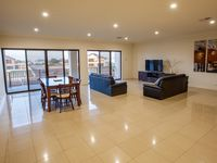 Spacious upstairs living area with views of the marina