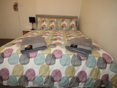 Queen bed wtih quality comfy mattress, 4 pillows, fitted sheet and doona