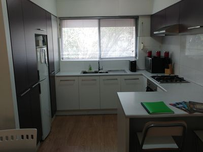 Spacious kitchen with ample storage.