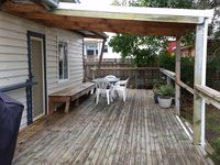 The deck is perfect for relaxing on summer nights. Lots of room for bikes.