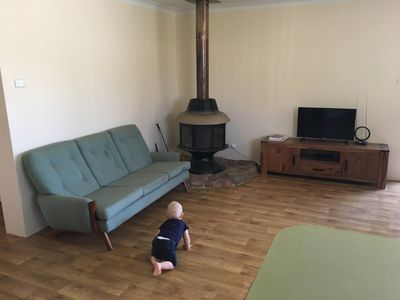 Living area with fireplace, couches for seating five, tv, dvd and toybox