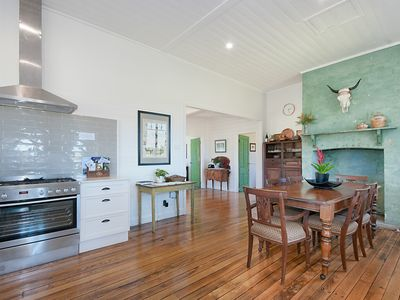 Open plan kitchen fully renovated with original fire place restored.