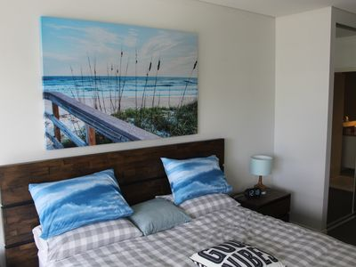 Cozy and comfortable main bedroom with a king size bed and ensuite