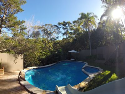 Pool and backyard looking onto bushland