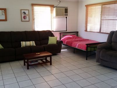 Living area is air conditioned, extra long sofa, recliner and king single bed.