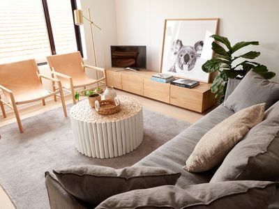Lounge with linen sofa and leather sling back chairs