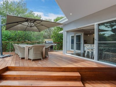 Large outdoor deck and lawned yard