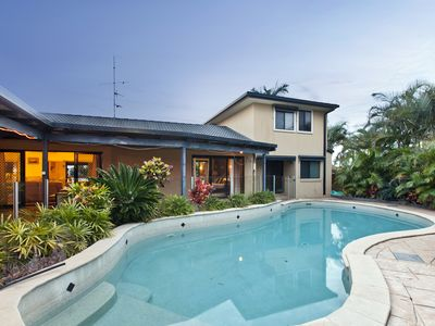 Spacious pool and outdoor lounge area for the whole family.