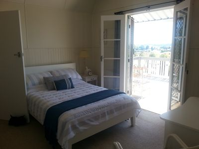 Main bedroom with French doors leading to a large sunny north facing balcony
