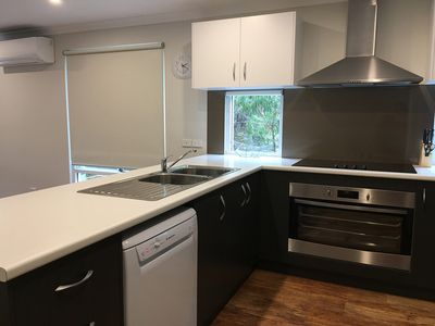 Kitchen with quality appliances including dishwasher and microwave