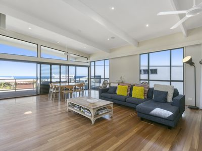 Spacious living area opening to deck - capturing lovely ocean views