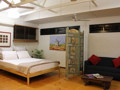 The Earth Garden bungalow has raked ceilings and a timber floor.
