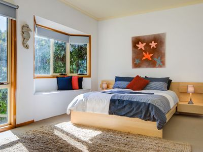 Huge, sunny master bedroom with window seat...