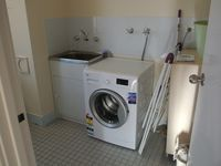 Laundry - located in the downstairs bathroom