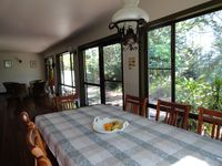 huge sunroom area with casual and formal dining
