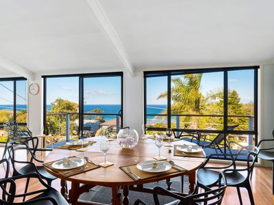 Front living, dining, kitchen with views to beach