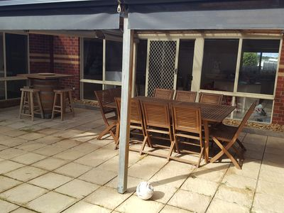 Undercover outside area with BBQ, leaner, table and bluetooth speaker